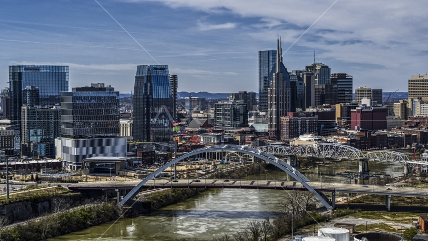 A bridge, and skyscrapers near the Cumberland River in Downtown Nashville, Tennessee Aerial Stock Photos | DXP002_116_0012