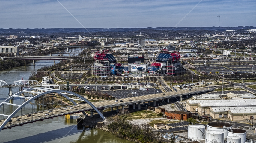 A view of Nissan Stadium from bridge in Nashville, Tennessee Aerial Stock Photos | DXP002_116_0017