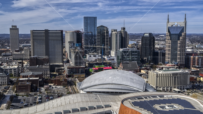 A view of the city's skyline behind the arena, Downtown Nashville, Tennessee Aerial Stock Photos | DXP002_117_0010