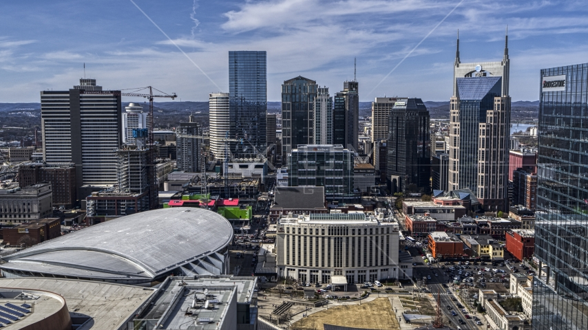 The city's skyline behind arena and hotel, Downtown Nashville, Tennessee Aerial Stock Photos | DXP002_117_0011