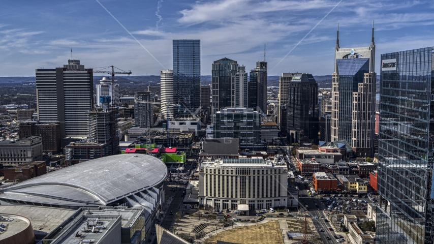 City's skyline behind the arena and hotel, Downtown Nashville, Tennessee Aerial Stock Photos   DXP002_117_0012
