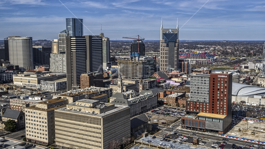 A high-rise hotel and skyscrapers in Downtown Nashville, Tennessee Aerial Stock Photos | DXP002_118_0001