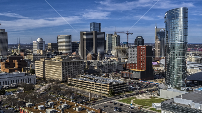 A view of tall skyscrapers and city buildings in Downtown Nashville, Tennessee Aerial Stock Photos | DXP002_118_0004