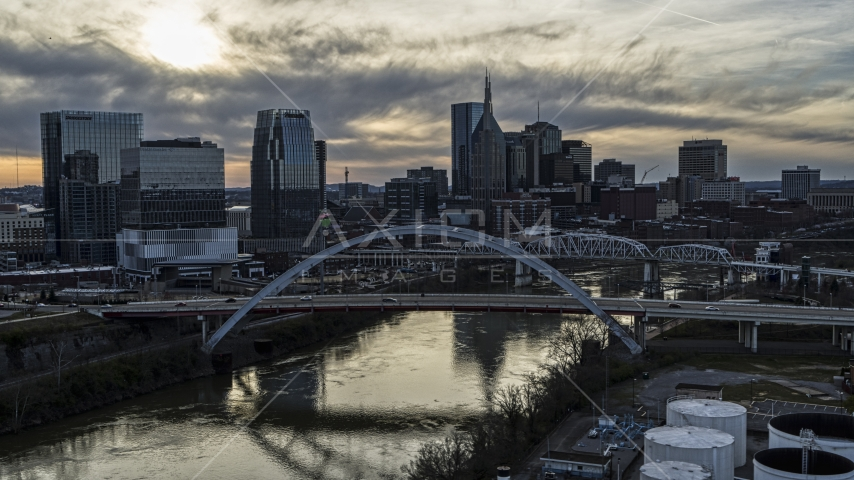 The city's skyline and bridges over the Cumberland River at sunset, Downtown Nashville, Tennessee Aerial Stock Photo DXP002_119_0007 | Axiom Images