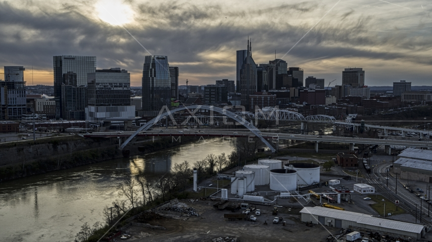City skyline by bridges and Cumberland River at sunset, Downtown Nashville, Tennessee Aerial Stock Photos | DXP002_119_0008