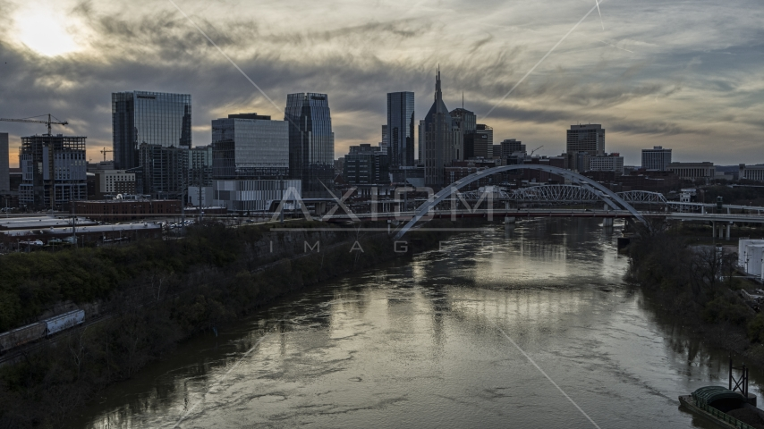 The city's skyline, bridges over the Cumberland River at sunset, Downtown Nashville, Tennessee Aerial Stock Photos | DXP002_119_0011