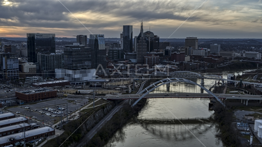 The skyline and a bridge over the Cumberland River at sunset, Downtown Nashville, Tennessee Aerial Stock Photos | DXP002_119_0015