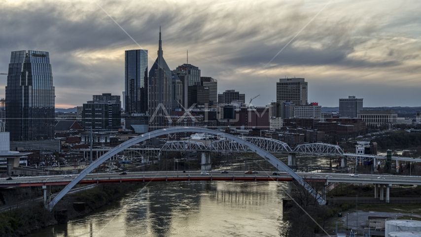 Riverfront skyline seen from a bridge and Cumberland River at sunset, Downtown Nashville, Tennessee Aerial Stock Photos | DXP002_120_0003