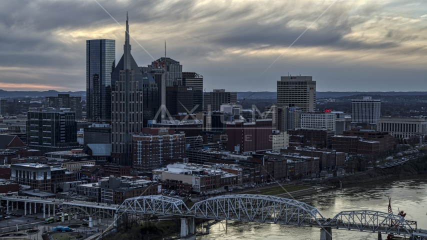 The riverfront skyline, and a bridge spanning the Cumberland River at sunset, Downtown Nashville, Tennessee Aerial Stock Photos | DXP002_120_0005
