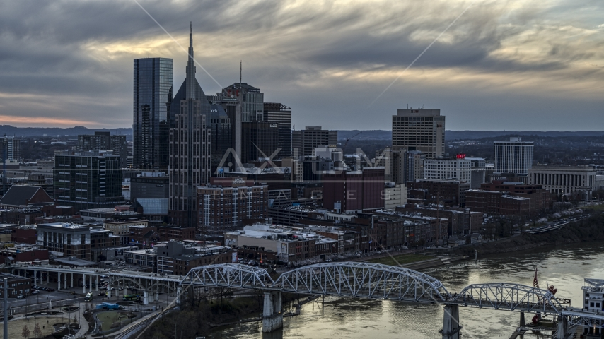 Riverfront skyline, pedestrian bridge, and Cumberland River at sunset, Downtown Nashville, Tennessee Aerial Stock Photos | DXP002_120_0006