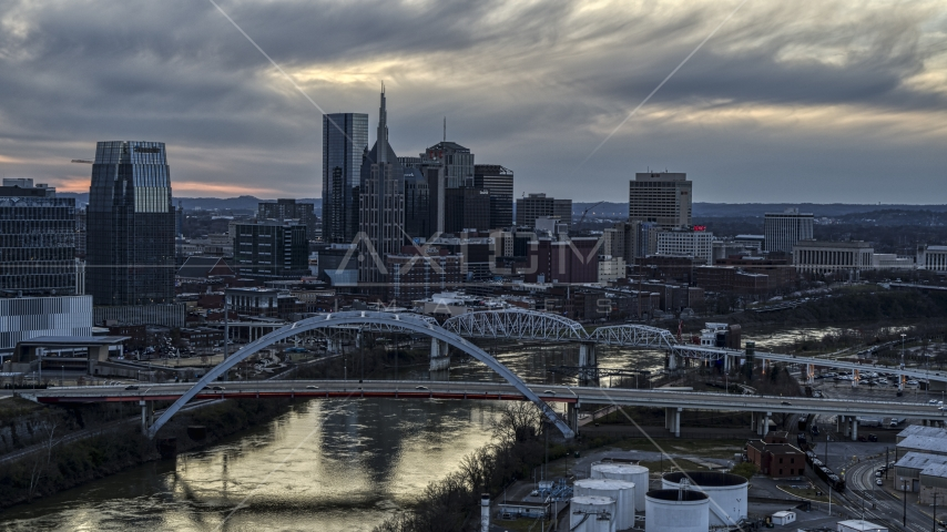 The riverfront skyline, two bridges, and the Cumberland River at sunset, Downtown Nashville, Tennessee Aerial Stock Photos | DXP002_120_0007