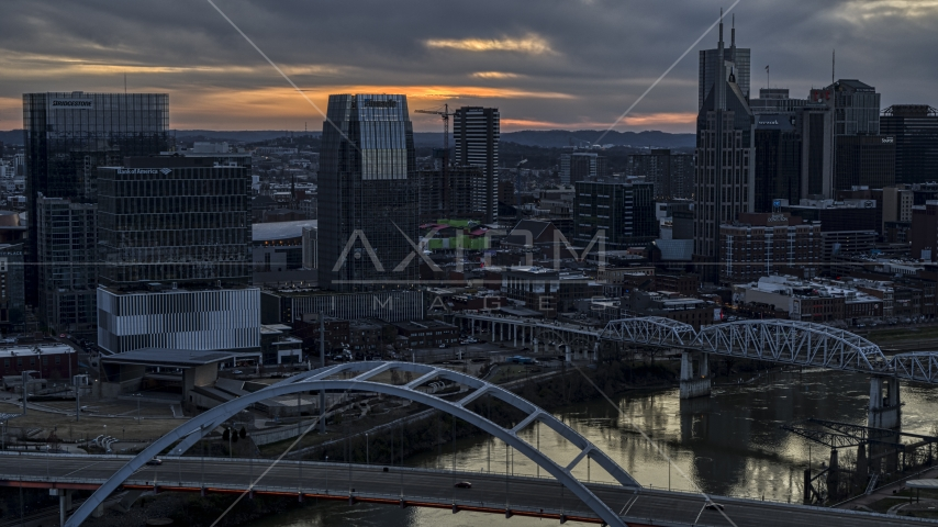 The Pinnacle skyscraper and a bridges on the river at sunset, Downtown Nashville, Tennessee Aerial Stock Photos | DXP002_120_0010