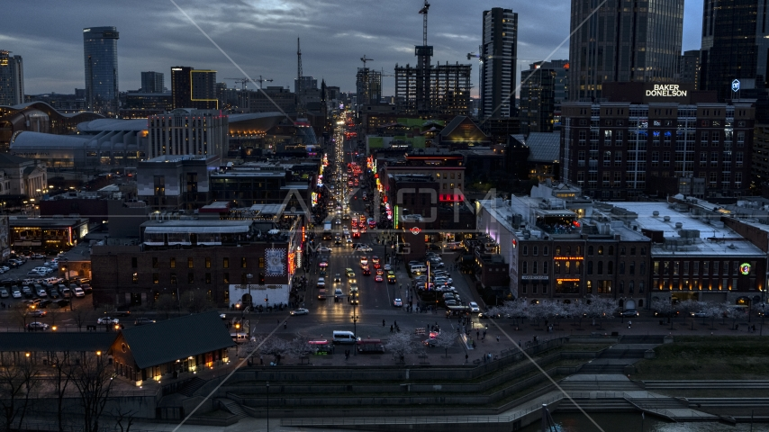 Buildings, cars and pedestrians around Broadway at twilight, Downtown Nashville, Tennessee Aerial Stock Photos DXP002_120_0012 | Axiom Images
