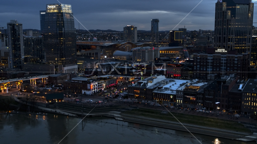Riverfront buildings, cars on Broadway at twilight, Downtown Nashville, Tennessee Aerial Stock Photos | DXP002_120_0013