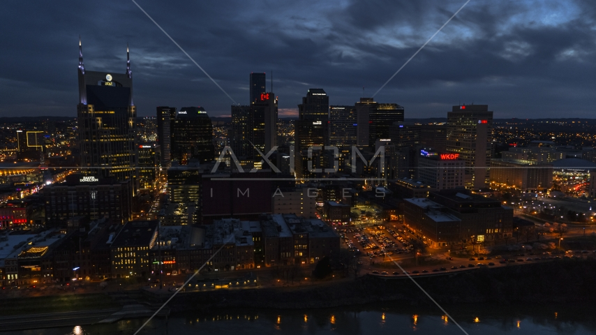 AT&T Building and the city's skyline at twilight, seen from Cumberland River, Downtown Nashville, Tennessee Aerial Stock Photos | DXP002_121_0003