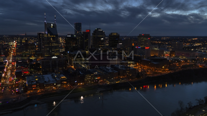 A view across the river toward the city's skyline at twilight, Downtown Nashville, Tennessee Aerial Stock Photos | DXP002_121_0004