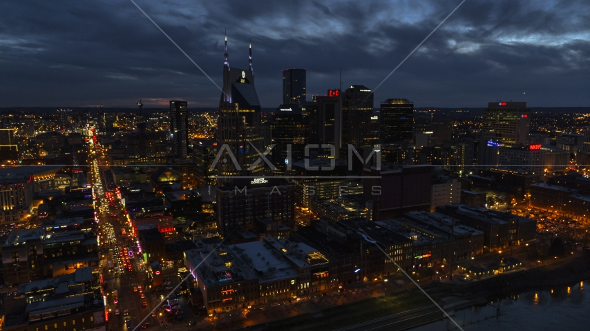 The AT&T Building skyscraper and city skyline at twilight, Downtown Nashville, Tennessee Aerial Stock Photos | DXP002_121_0005