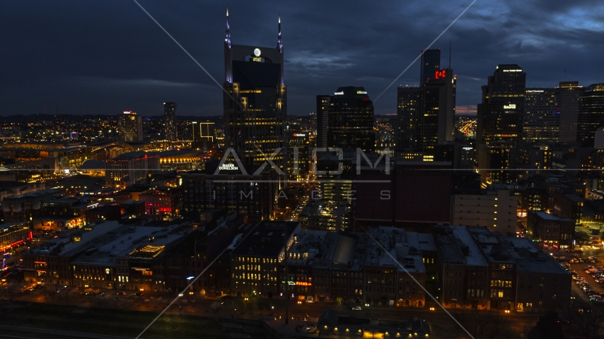 A view of the AT&T Building and skyline at twilight, Downtown Nashville, Tennessee Aerial Stock Photos | DXP002_121_0006