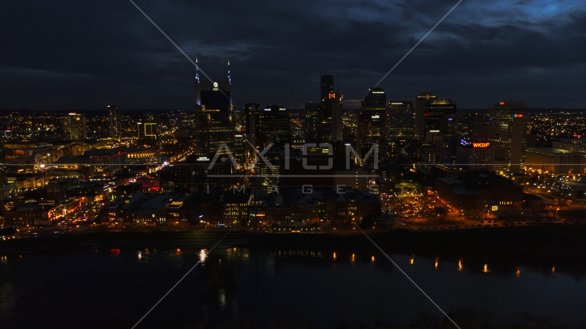 The city skyline and the AT&T Building across the river at twilight, Downtown Nashville, Tennessee Aerial Stock Photos   DXP002_121_0010