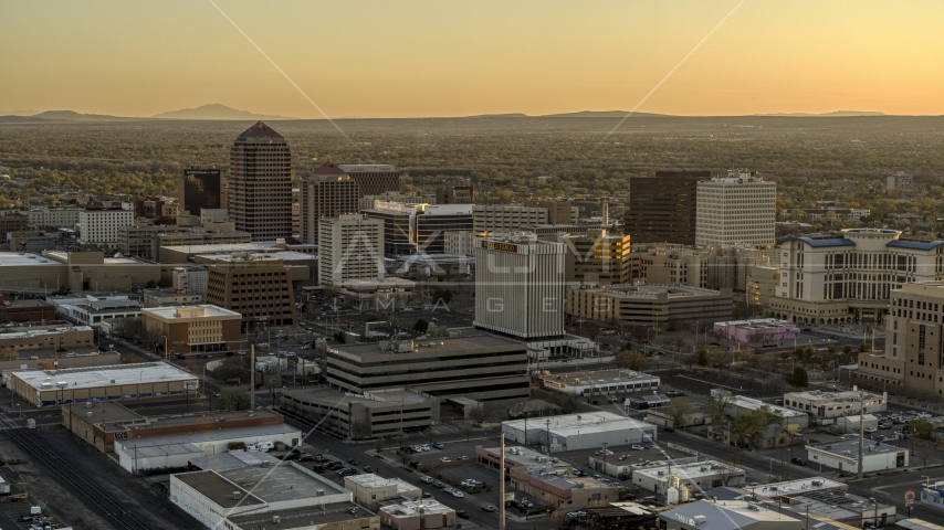 A view of high-rise office buildings at sunset, Downtown Albuquerque, New Mexico Aerial Stock Photos | DXP002_122_0008