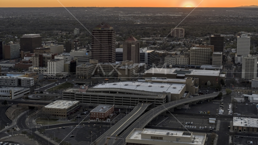 Office high-rises and convention center near office tower and shorter hotel tower at sunset, Downtown Albuquerque, New Mexico Aerial Stock Photos | DXP002_122_0010