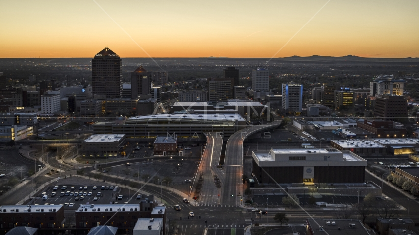 A view of Albuquerque Plaza, Hyatt Regency and city high-rises at sunset, Downtown Albuquerque, New Mexico Aerial Stock Photos | DXP002_123_0005
