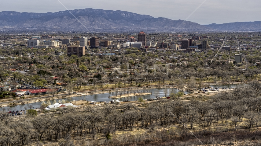 A wide view of high-rise office buildings seen from Tingley Beach, Downtown Albuquerque, New Mexico Aerial Stock Photo DXP002_124_0003 | Axiom Images