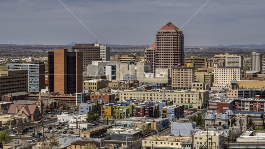 Albuquerque Plaza office high-rise and surrounding buildings, Downtown Albuquerque, New Mexico Aerial Stock Photo DXP002_124_0009 | Axiom Images