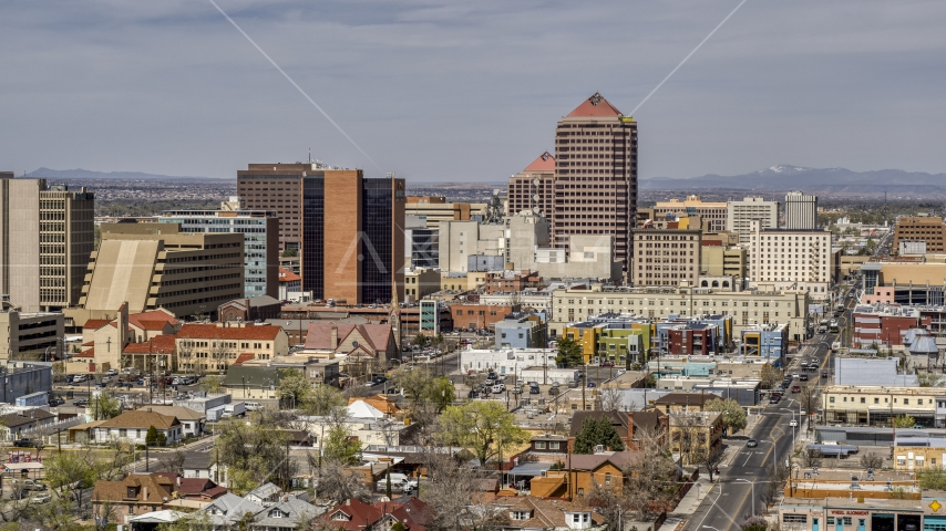 A view of Albuquerque Plaza office high-rise and surrounding buildings, Downtown Albuquerque, New Mexico Aerial Stock Photo DXP002_124_0010 | Axiom Images