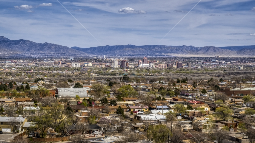 Suburban homes with a view of Downtown Albuquerque in the distance, New Mexico Aerial Stock Photos | DXP002_126_0001