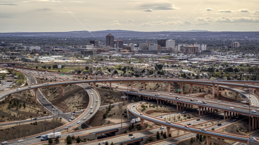 Downtown Albuquerque seen from freeway interchange traffic, New Mexico Aerial Stock Photos | DXP002_126_0003