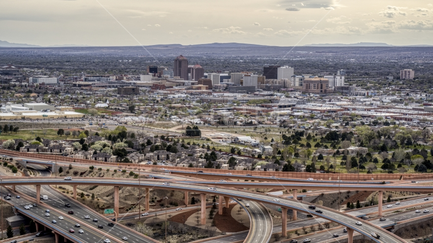 Downtown Albuquerque high-rises seen from a freeway interchange, New Mexico Aerial Stock Photo DXP002_126_0004 | Axiom Images