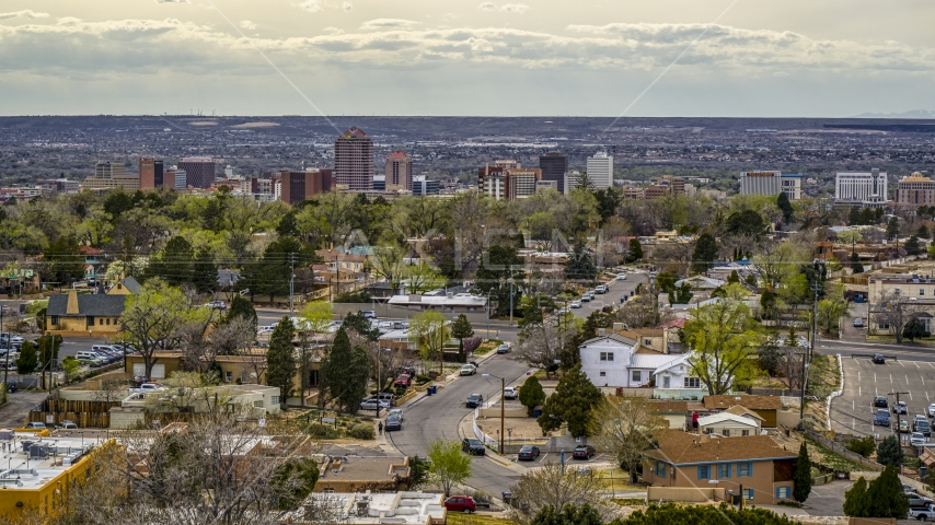 A wide view of city's high-rises seen from houses, Downtown Albuquerque, New Mexico Aerial Stock Photo DXP002_126_0006 | Axiom Images