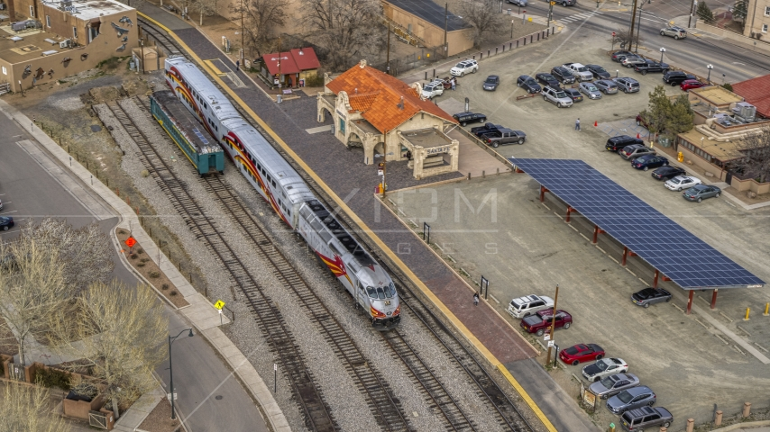 A view of a passenger train at the station in Santa Fe, New Mexico, tilt to top of the train Aerial Stock Photo DXP002_130_0008 | Axiom Images