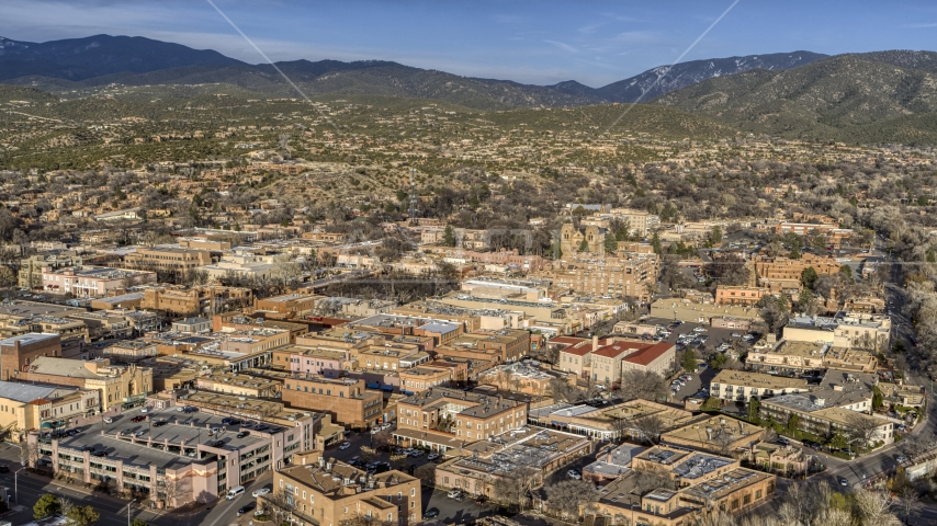 A view across downtown buildings in Santa Fe, New Mexico Aerial Stock Photos | DXP002_132_0001
