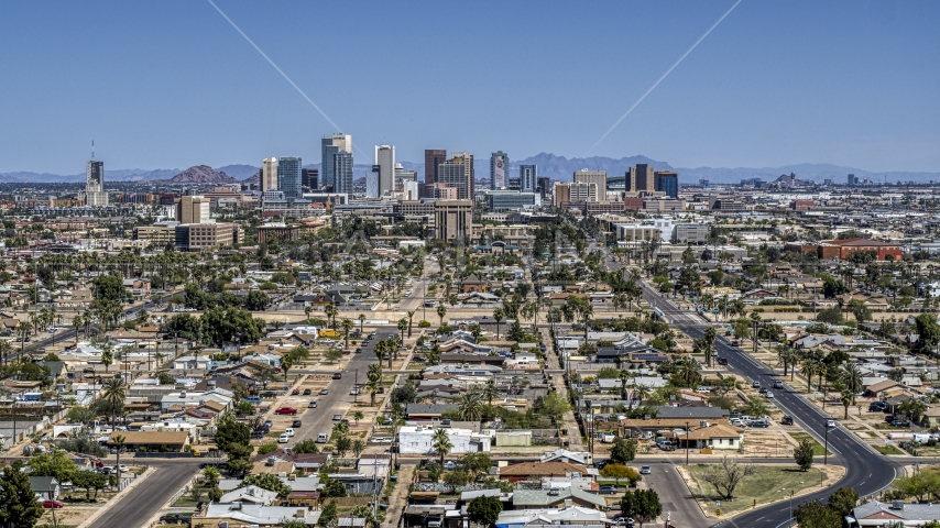 A view of the city's distant skyline, Downtown Phoenix, Arizona Aerial Stock Photos | DXP002_136_0010