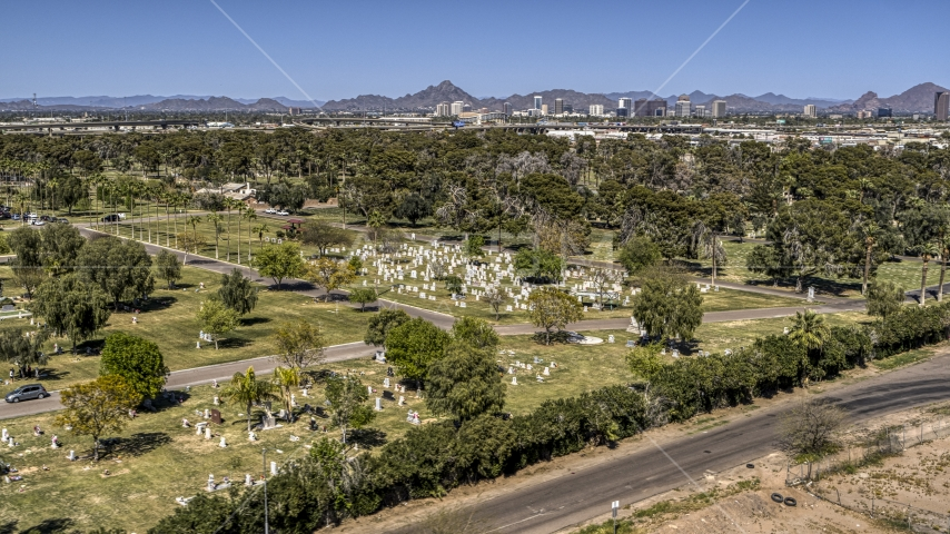 Green lawns, trees and grave markers at a cemetery in Phoenix, Arizona Aerial Stock Photos | DXP002_137_0001