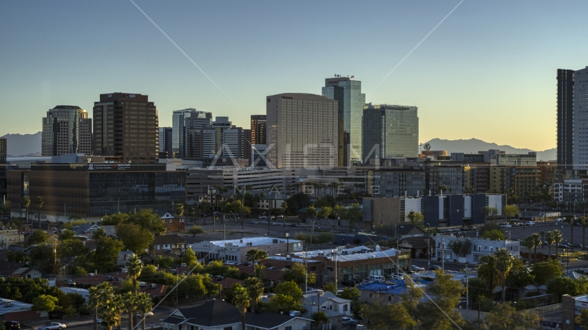 A hotel and high-rise office buildings at sunset in Downtown Phoenix, Arizona Aerial Stock Photos | DXP002_138_0011