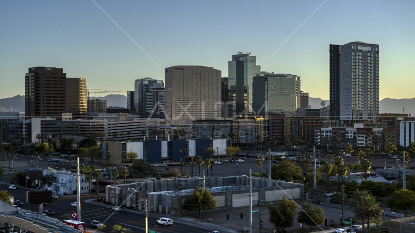 A hotel and tall office buildings at sunset in Downtown Phoenix, Arizona Aerial Stock Photos | DXP002_138_0012