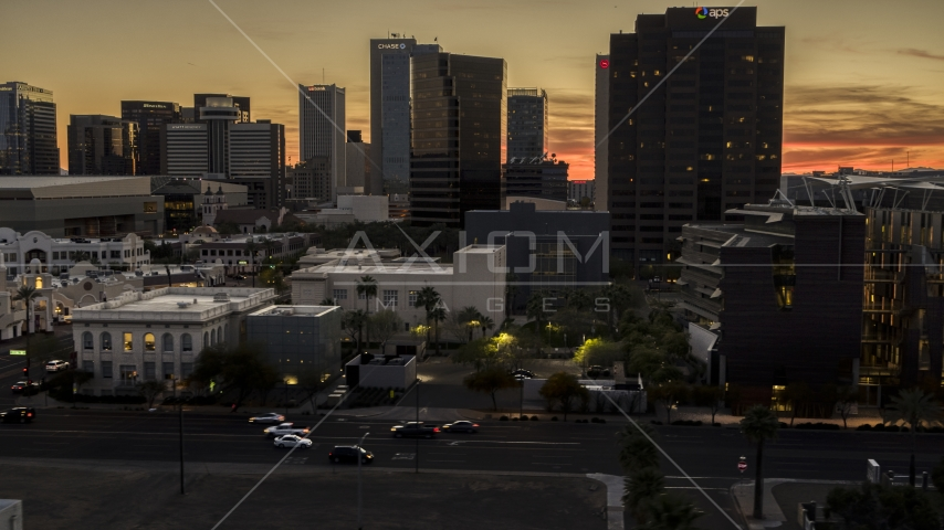 A view of tall office high-rises at sunset in Downtown Phoenix, Arizona Aerial Stock Photos | DXP002_139_0002