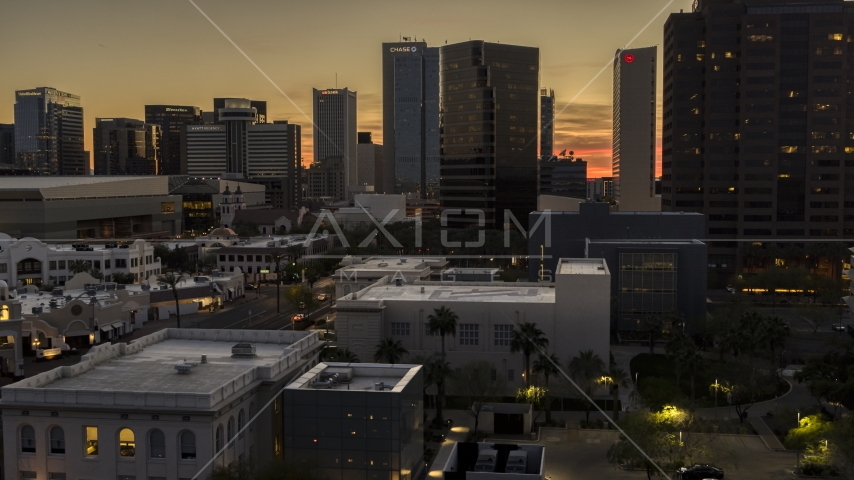 A group of high-rise office towers at sunset in Downtown Phoenix, Arizona Aerial Stock Photos | DXP002_139_0004