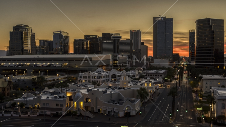 The city's office high-rises at sunset in Downtown Phoenix, Arizona Aerial Stock Photos | DXP002_139_0006