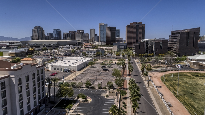 A view of the city's skyline on a sunny day in Downtown Phoenix, Arizona Aerial Stock Photos | DXP002_140_0002
