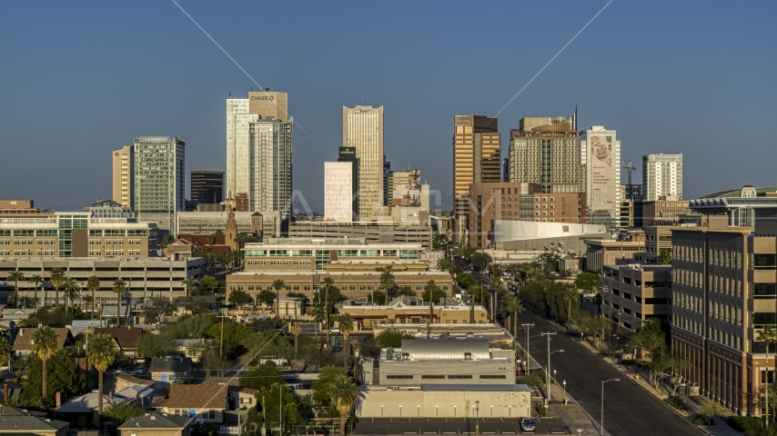A view of high-rise office buildings of the city's skyline at sunset in Downtown Phoenix, Arizona Aerial Stock Photos | DXP002_143_0002