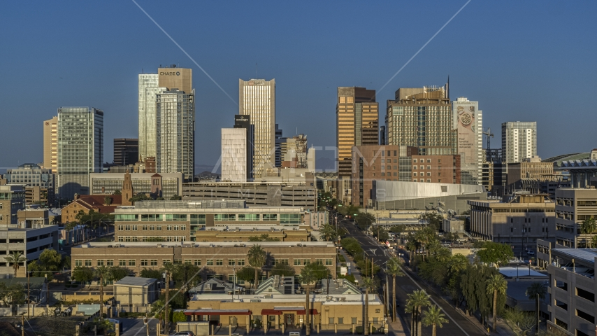 The city's skyline at sunset in Downtown Phoenix, Arizona Aerial Stock Photos | DXP002_143_0004