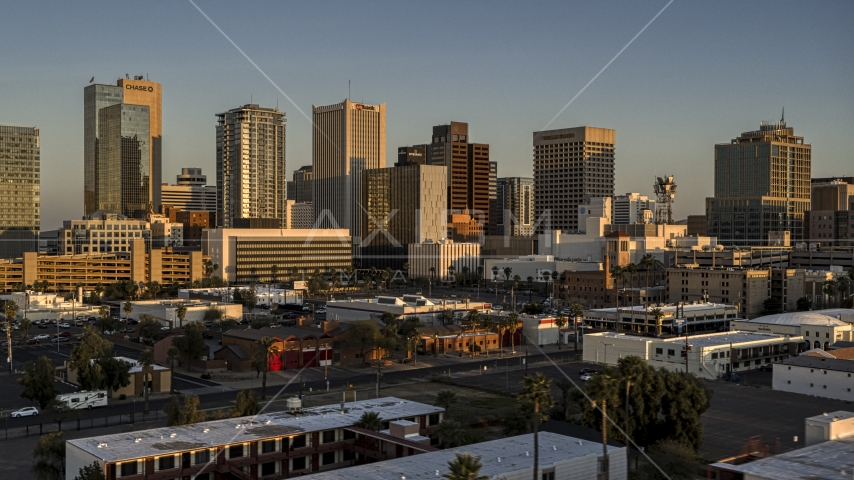 A view of the tall office buildings in the city's skyline at sunset, Downtown Phoenix, Arizona Aerial Stock Photo DXP002_143_0006 | Axiom Images