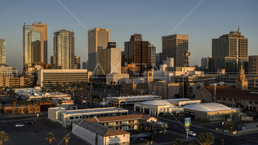 The city's tall skyline at sunset, Downtown Phoenix, Arizona Aerial Stock Photo DXP002_143_0007 | Axiom Images