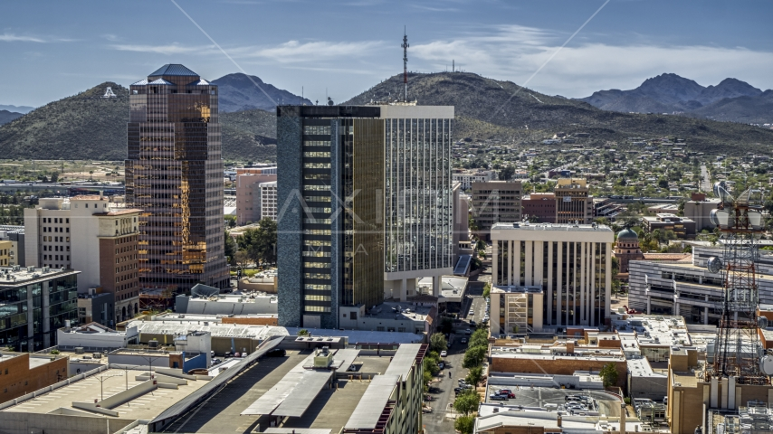 Three office towers with Sentinel Peak behind them, Downtown Tucson, Arizona Aerial Stock Photos | DXP002_144_0005