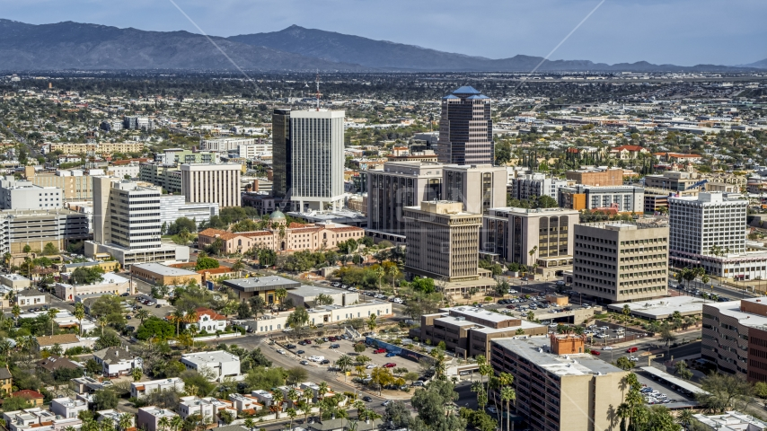 A view of tall high-rise office towers and city buildings in Downtown Tucson, Arizona Aerial Stock Photos | DXP002_144_0007