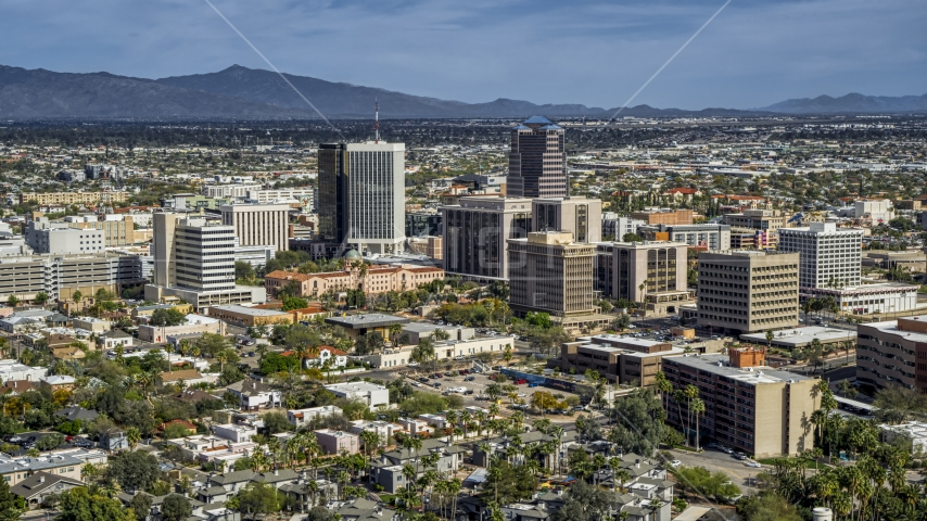 A pair of tall high-rise office towers and city buildings in Downtown Tucson, Arizona Aerial Stock Photos | DXP002_144_0009